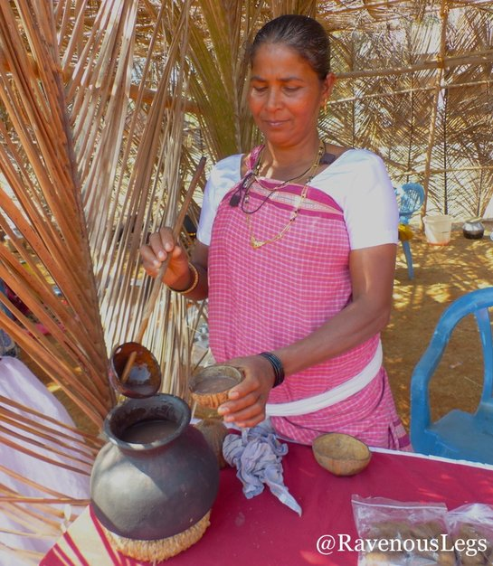 Woman serving Ambil at Goa Tribal Festival Xeldem