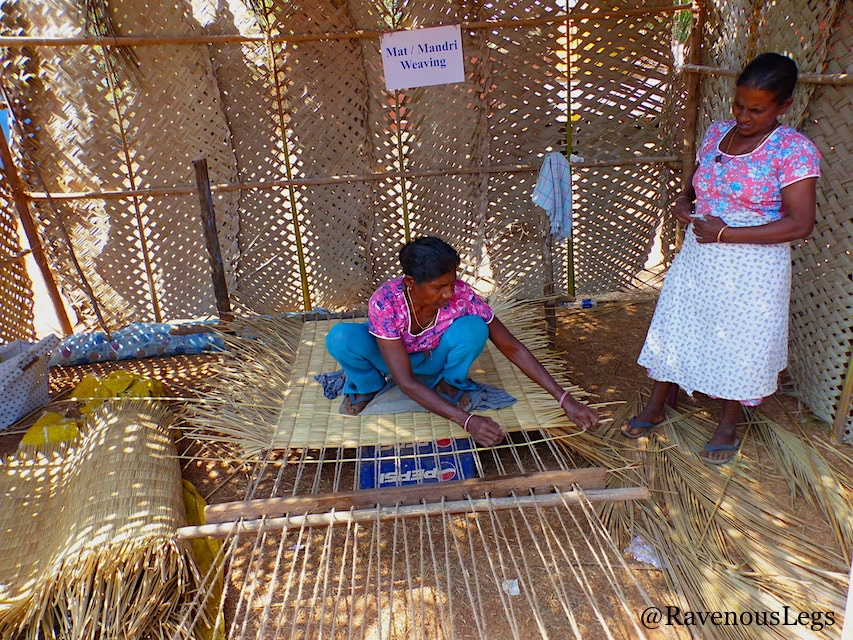 Women weaving mats at Goa Tribal Festival Xeldem